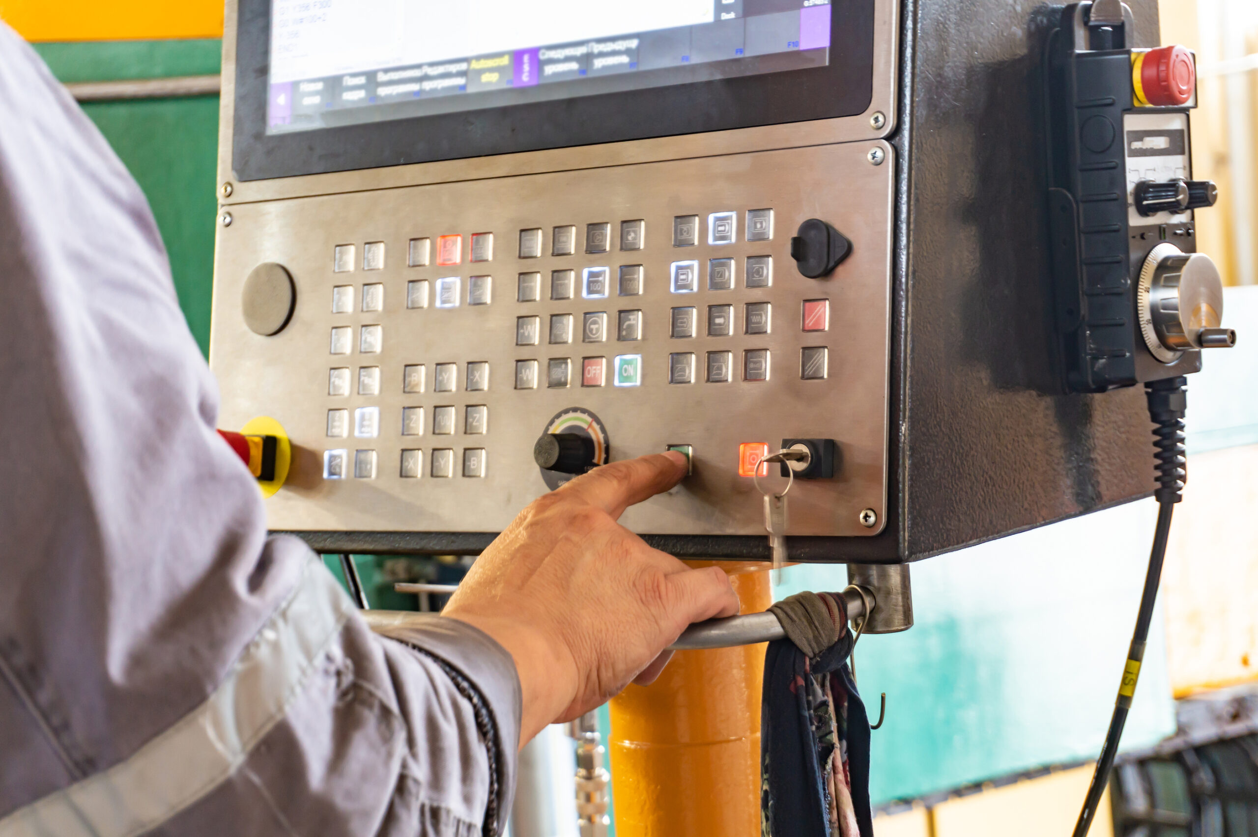 The cnc operator writes a program to control the metal processing machine. Management of the machining center.
