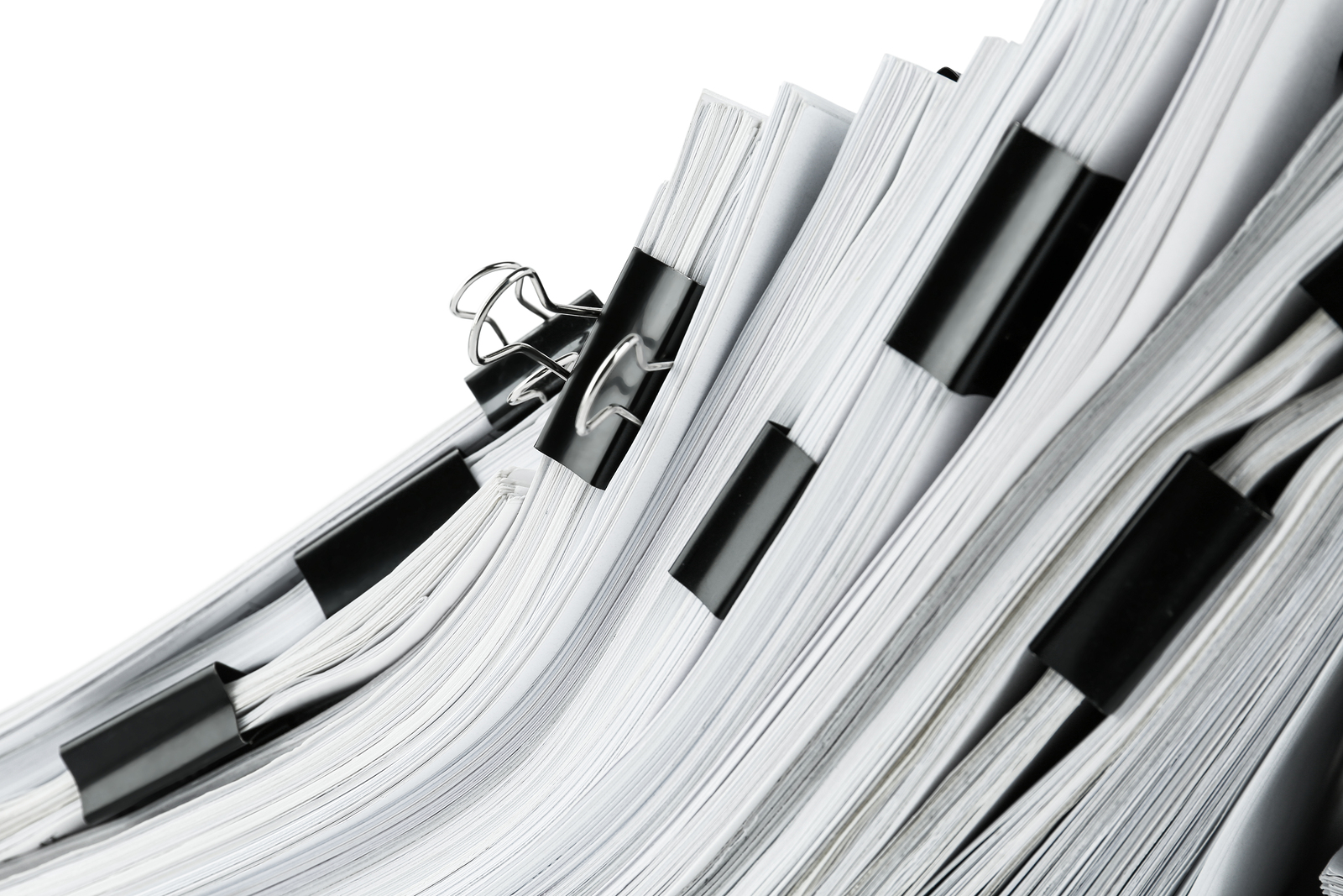 Pile of documents with binder clips, closeup
